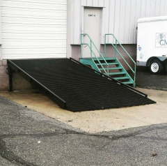 Custom fabricated grated steel ramp for a loading dock at a local business